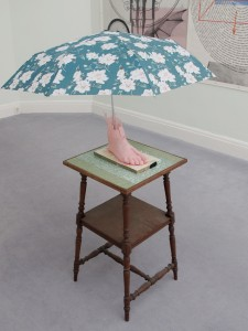 Schirmling, 2011, resin imprint of artist's foot, umbrella, wooden panel, table, 138 x 43 x 43 cm, Extradosis, Kunsthalle zu Kiel, 2011