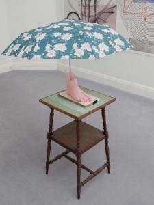 Schirmling, 2011, resin imprint of artist's foot, umbrella, wooden panel, table, 138 x 43 x 43 cm, Extradosis, Kunsthalle zu Kiel, 2011