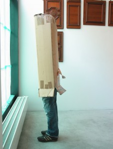 Brinkmann, 2006, cardboard, athletic shoes and jeans from the artist, plastic legs, 193 x 40 x 34 cm