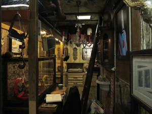 Kista del Sol, 2015, found objects, wallpaper, lights, colour, coffee, plexiglass, recordplayer, radio, 2,4 x 1,5 x 4,3 m