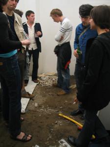 Mai und Materie _Exhibitionview 4, 2003, 1.5 cubic meter gravel, discarded items, Size Variable, Gallery Taubenstrasse, Hamburg_Brinkmann